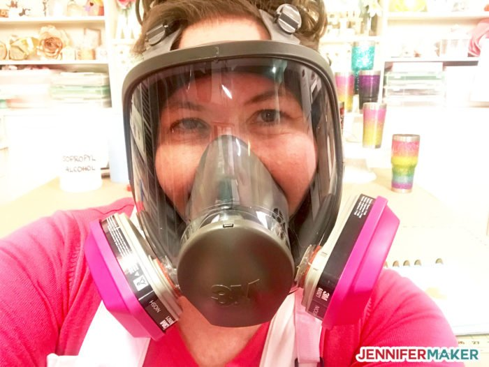 Jennifer Maker in her full face respirator with organic vapor filter cartridges practicing her epoxy safety tips