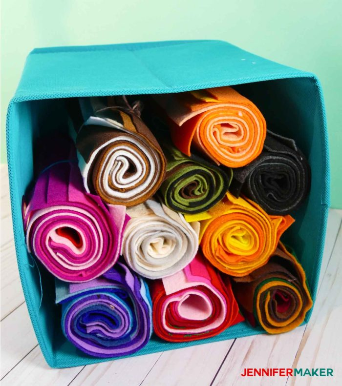 Rolled felt store in a soft side cube is an awesome fabric organization idea