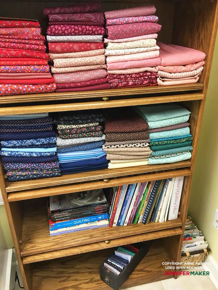 Store fabric in a glass-fronted bookcase for a great fabric organization idea!