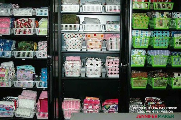Store fabric in bins in cabinets for a great fabric organization idea!