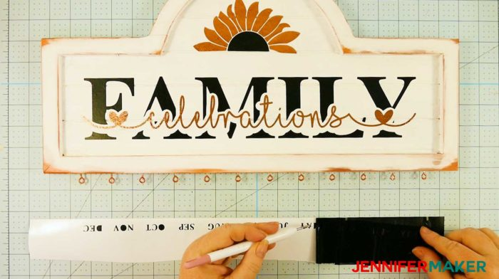 Weeding black vinyl months to put on the bottom of a family celebration and birthday board