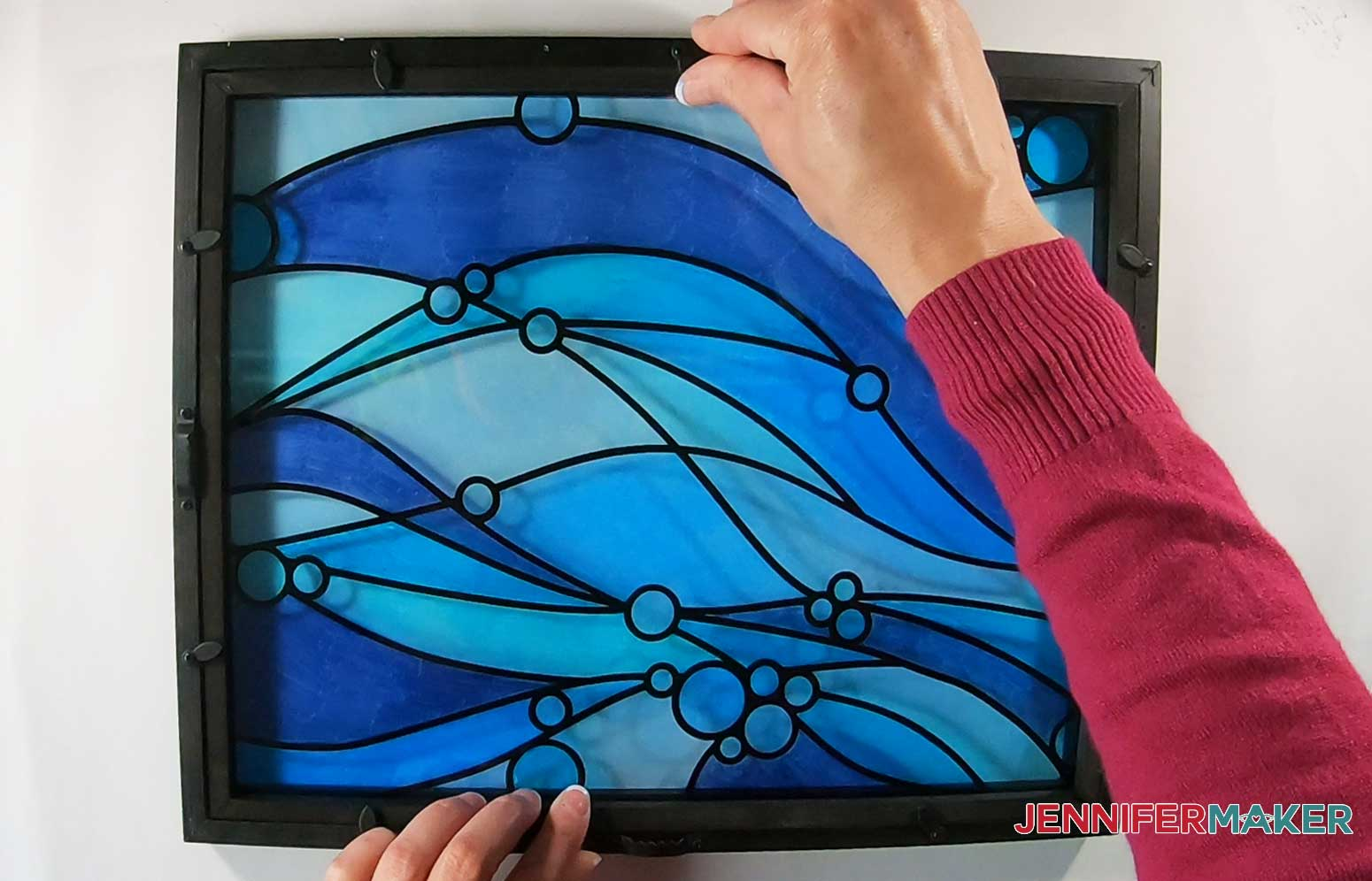 Assemble the faux stained glass frame by closing the tabs