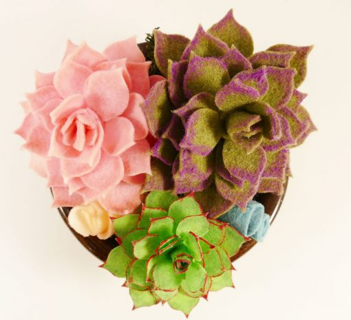 An arrangement of pretty felt succulents in a bowl