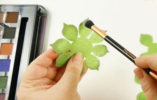 Coloring the felt succulent leaves with eye shadow