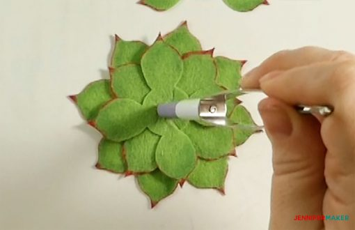 Press down again in the center of the felt succulent leaves