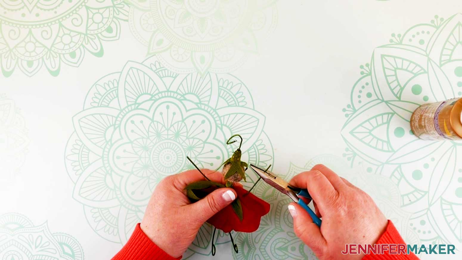 Curling wire hands and shaping arms of flower fairy doll
