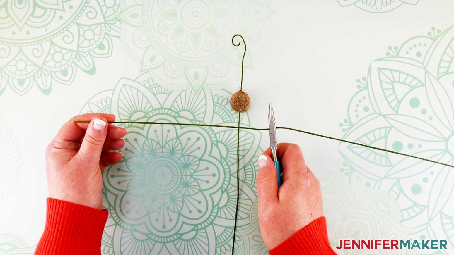 Cutting second wire of flower fairy doll in half