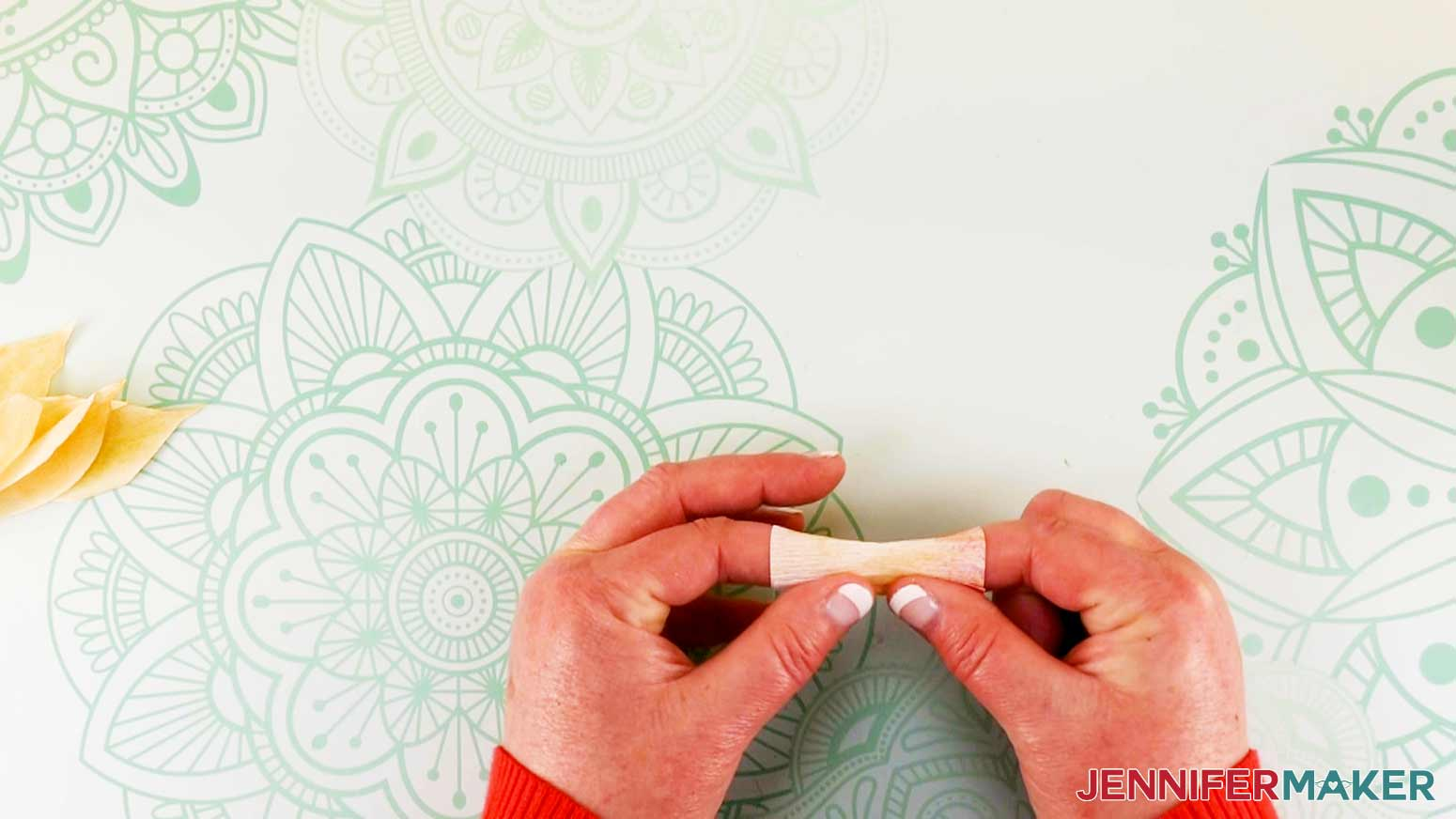Gluing rectangle into tube shape of daffodil flower fairy doll