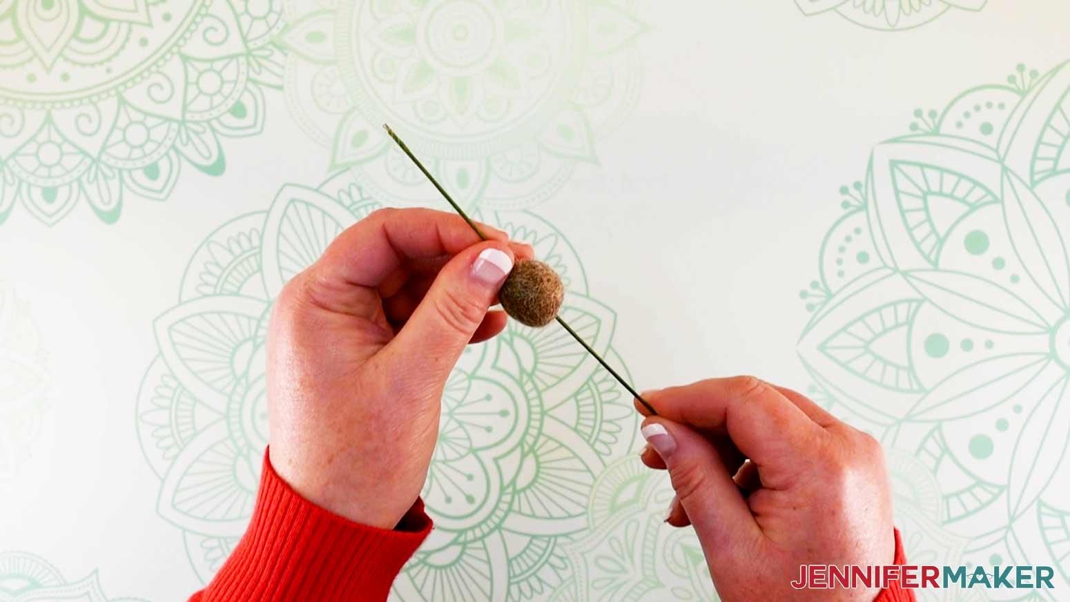 Feeding wire through wool ball head of flower fairy doll