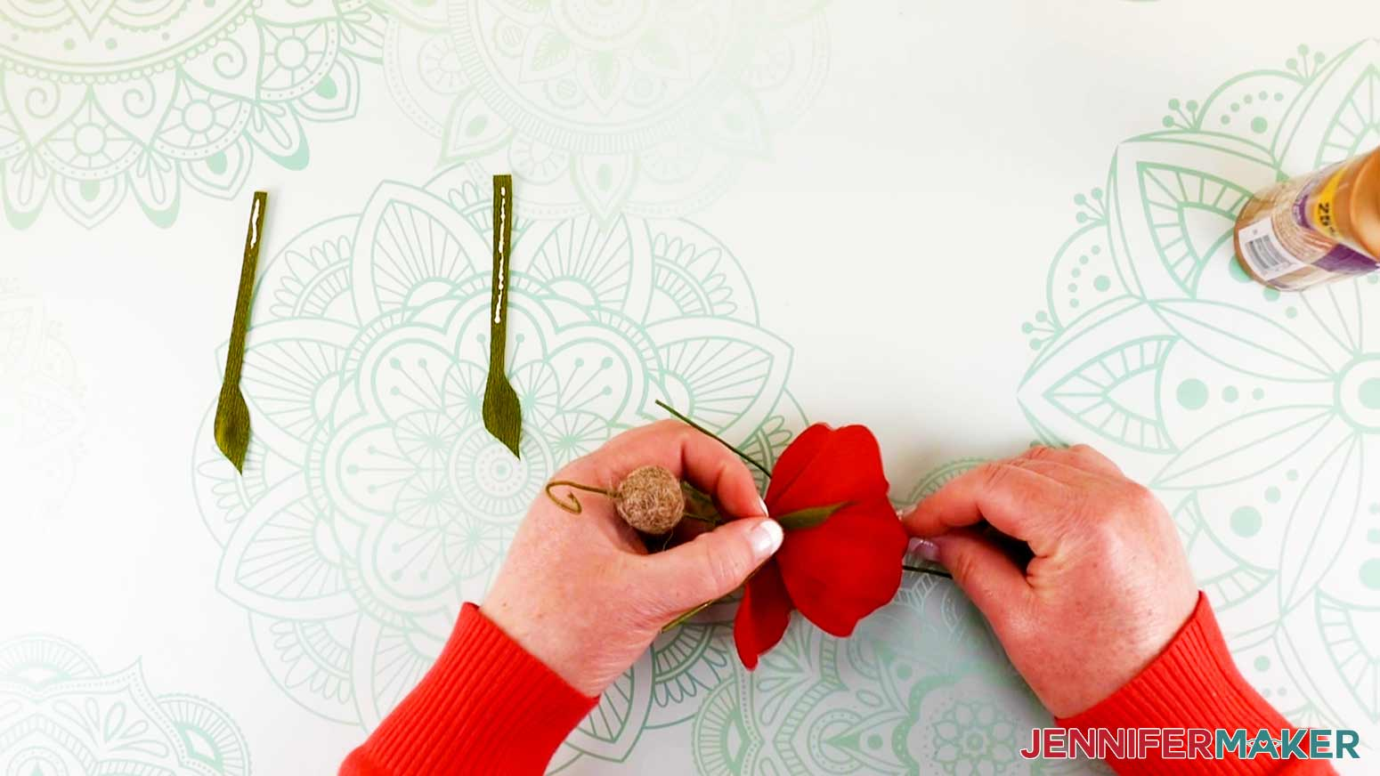 Holding leaf in place while wrapping end around bodice of peony flower fairy doll