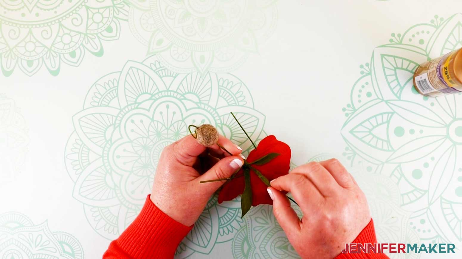 Wrapping remaining leaves around bodice of peony flower fairy doll