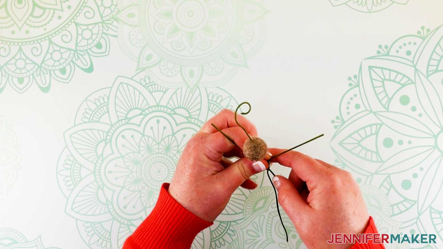 Pulling back center body wire of flower fairy doll into tail position