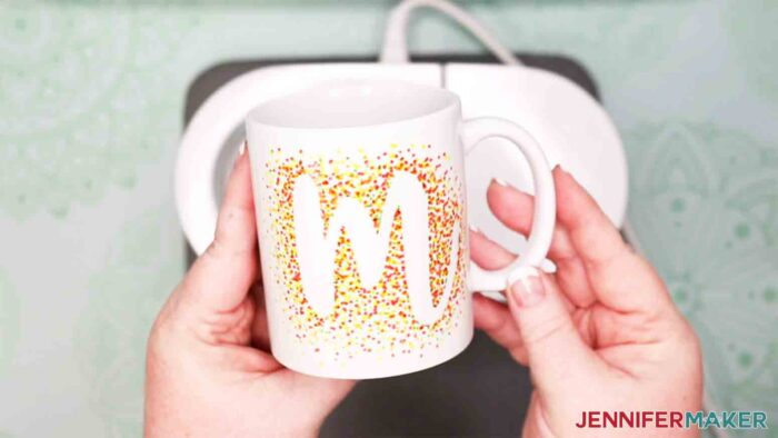 showing the letter m freehand mug