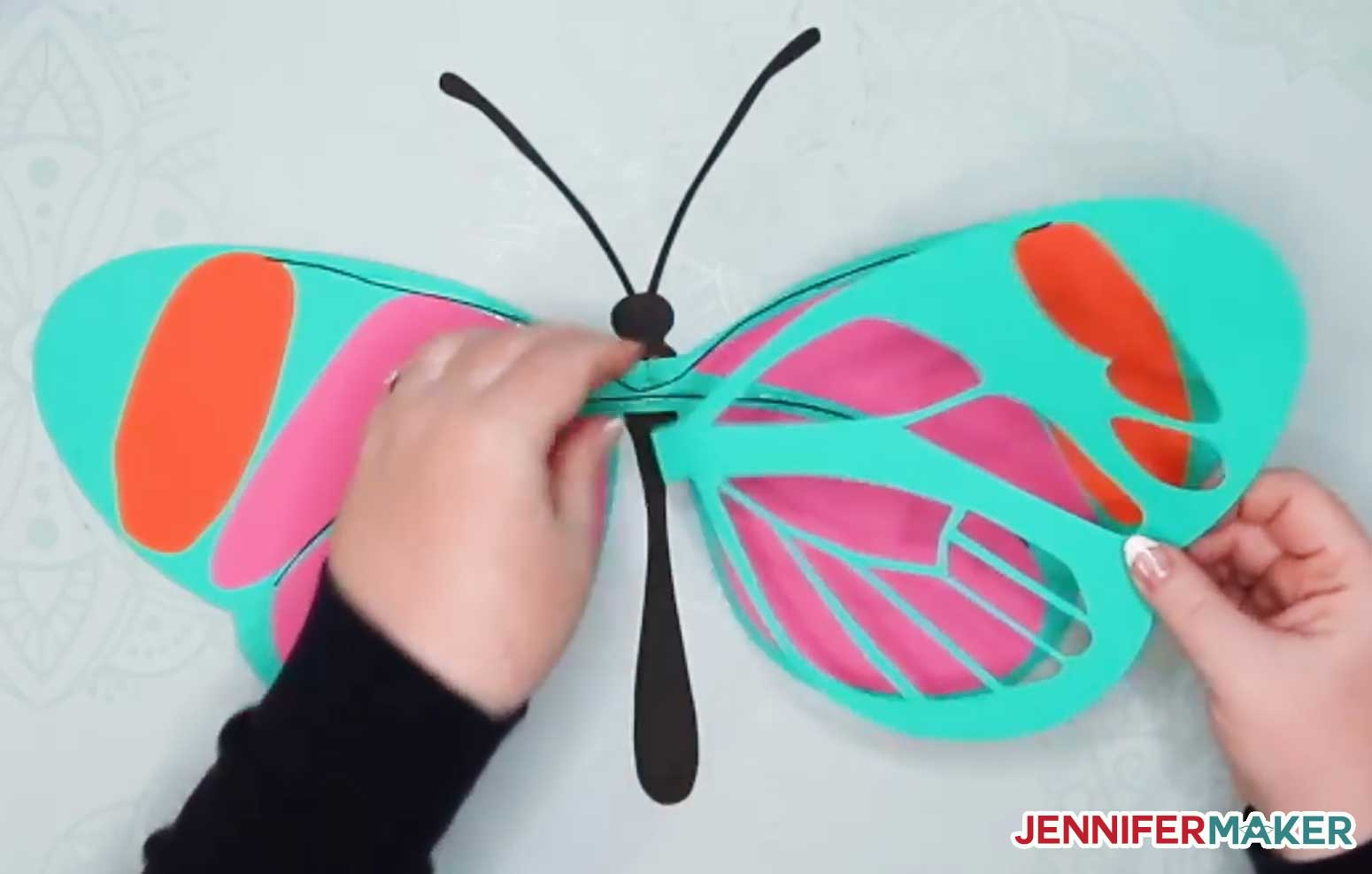 Place the back side of the wing on your giant paper butterfly