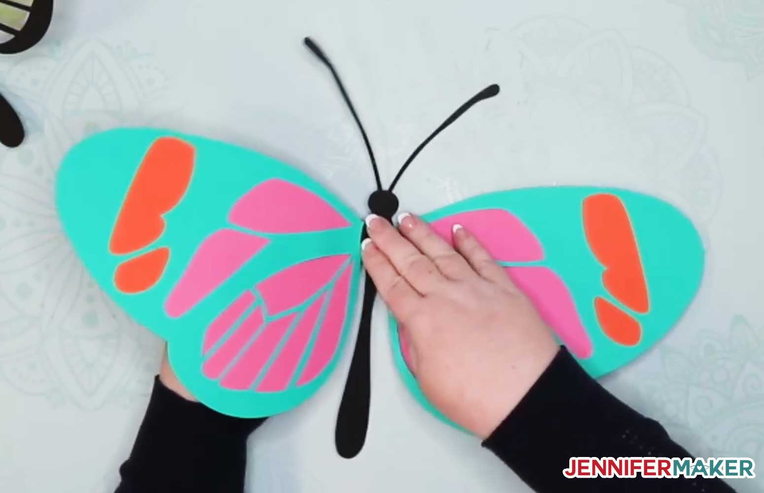 Folding up the wings on the giant paper butterfly