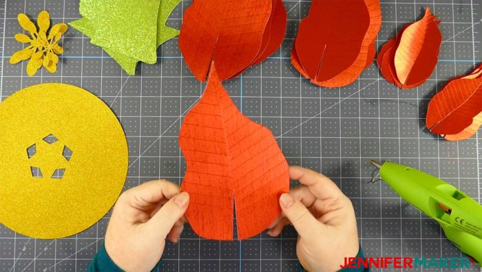 Cut paper pieces for the giant paper poinsettia flower