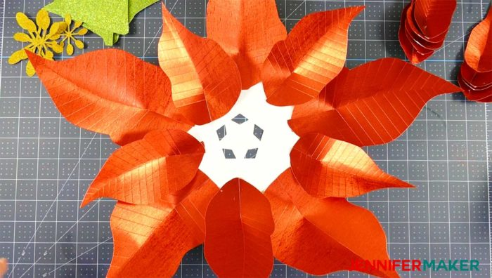 Arranging the leaves on the giant paper poinsettia flower