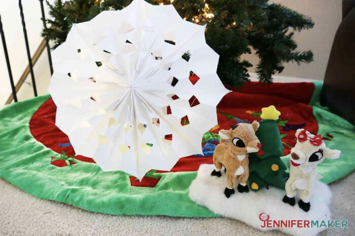 Giant paper snowflake under a Christmas Tree