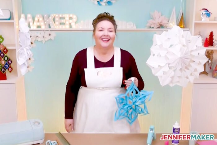 Giant Paper Snowflakes in blue and white with Jennifer Maker in her craft room