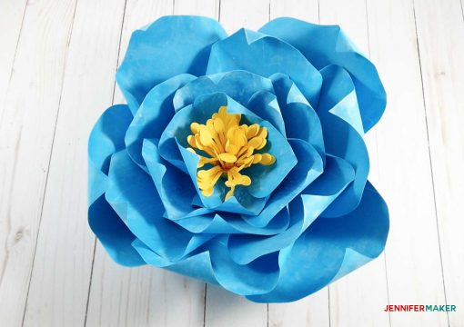 The finished blue giant paper winter rose with a yellow stamen