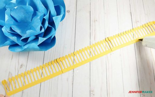 Gluing the yellow stamen strip for the giant paper winter rose