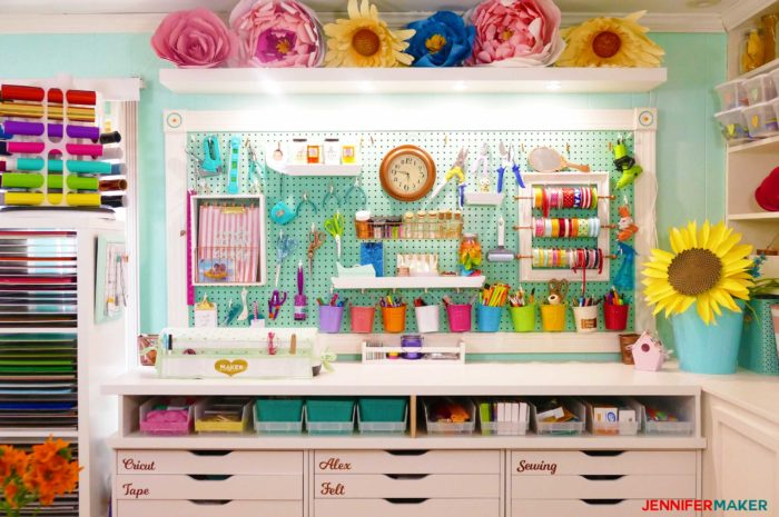 My large framed pegboard filled with craft tools, accessories, buckets, shelves, and my ribbon storage!