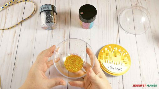 Fill up one half of the clear ornament with gold glitter