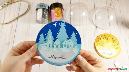 Attach the final layer of your scene for your glitter ball ornament
