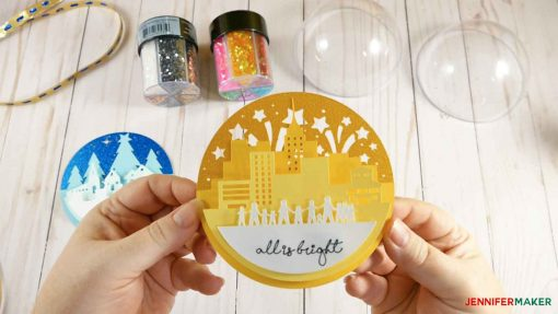 "Glue the ""all is bright"" scene for your glittler ornament"