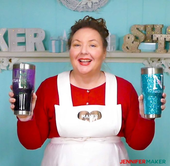 Jennifer holding two glitter tumblers in her craft room