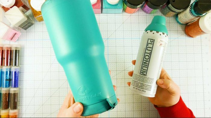 Painting your stainless steel tumbler with Plutonium paint before you glitter it