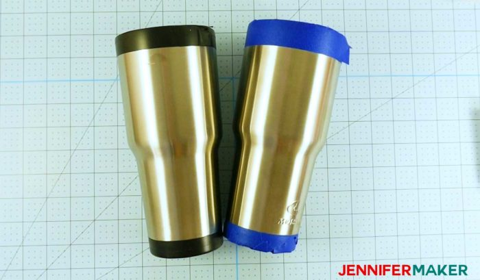 Two tumblers taped at the top and bottom in preparation to become a glitter tumbler