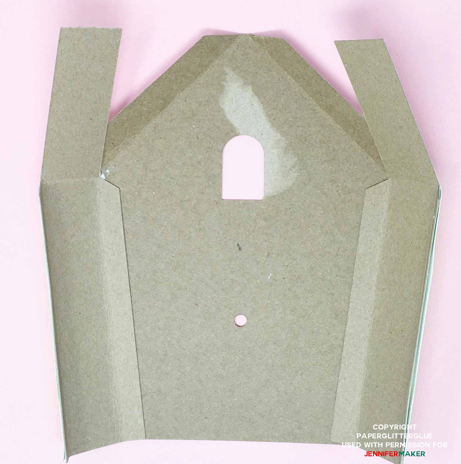 Cardboard side pieces glued to back piece of DIY cuckoo clock