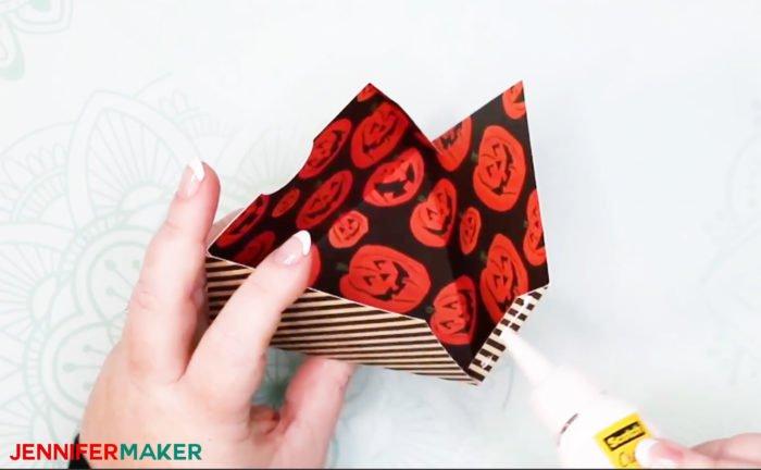 Gluing a cardstock treat box for the DIY Halloween Countdown Calendar