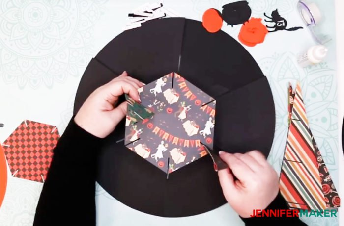 Sliding the supports into the hat brim of the DIY Halloween Countdown Calendar