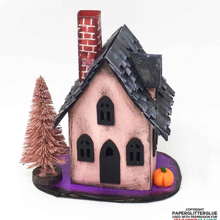 Halloween Paper Haunted House with pink stucco and a black roof