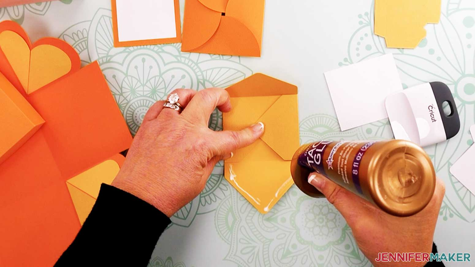 Add glue to the envelope flap for my heart explosion box