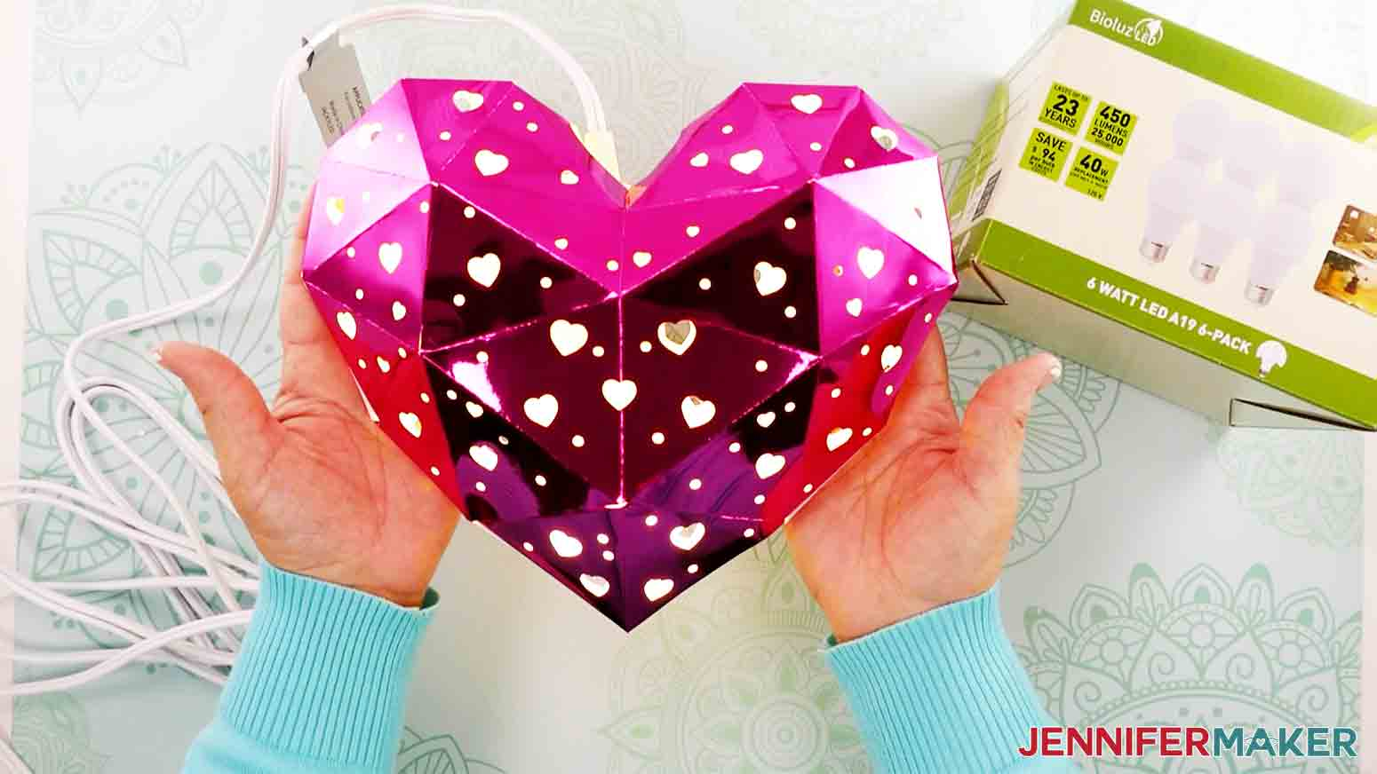 holding up the finished heart lantern