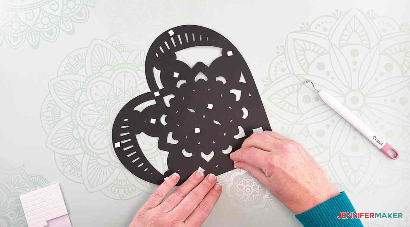 Add foam adhesive squares to the back side of layer three to make my heart mandala