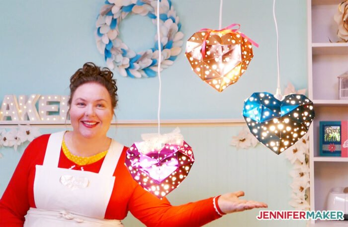 Jennifer Maker with her heart-shaped hanging paper lanterns made from metallic cardstock and Kraft board