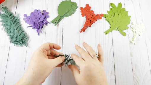 Fold your paper leaves and branches for your holiday kissing ball