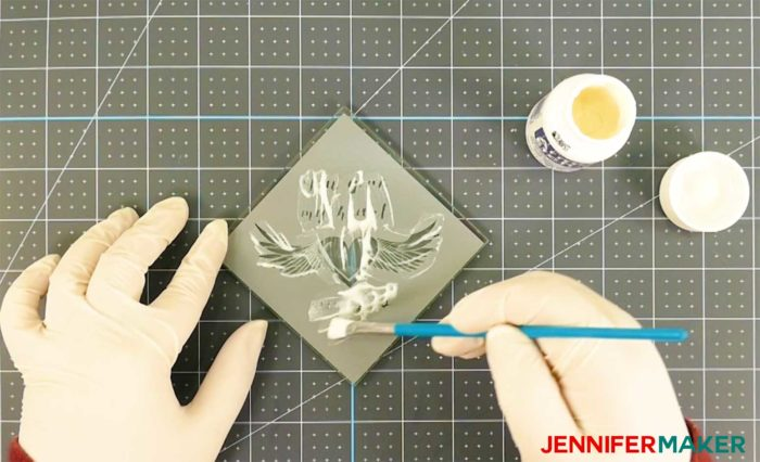 Brushing armour etch etching cream onto a glass coaster with a vinyl decal - how to etch glass
