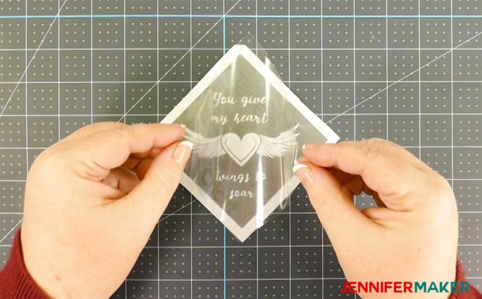 Placing transfer tape over a vinyl decal for glass etching