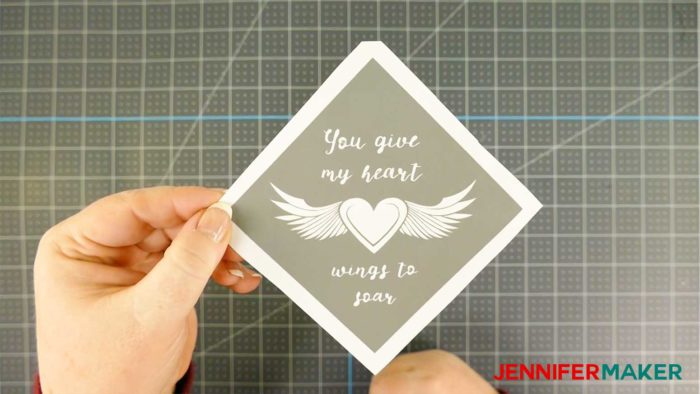 A vinyl decal with a winged heart for etching a glass coaster