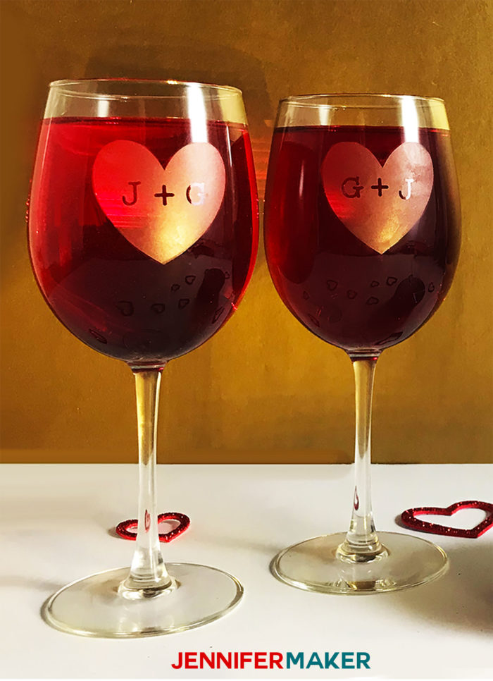 Etched wine glasses with red wine