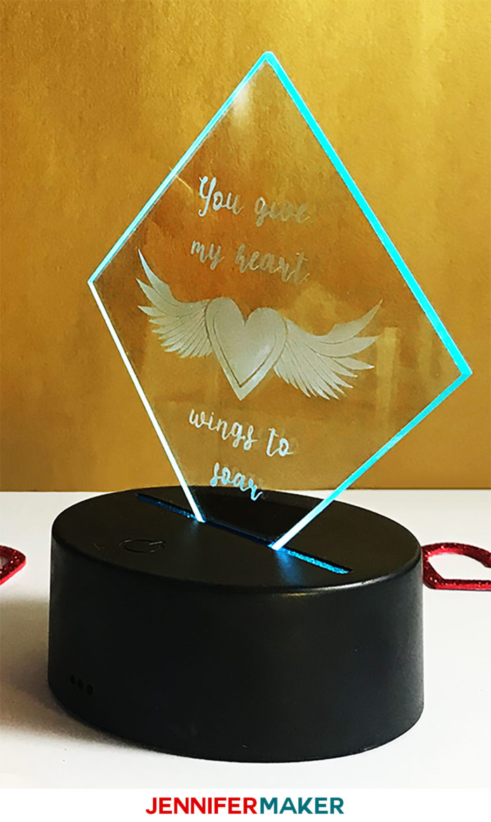 Etched glass plaque with LED base with a winged heart
