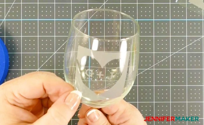 Smoothing vinyl on the curved surface of a wine glass for etching - how to etch glass