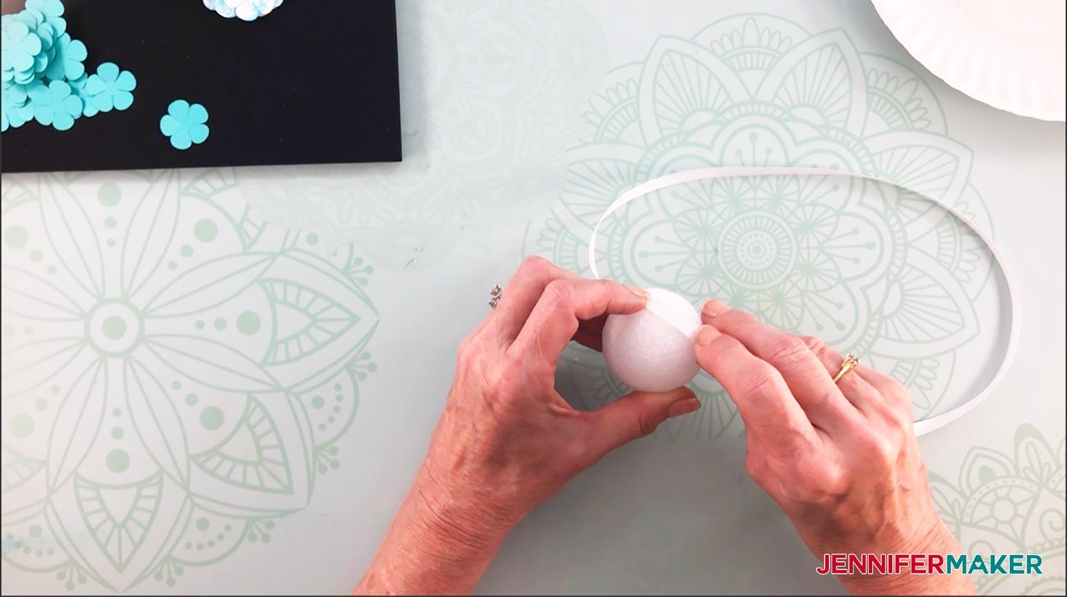 Make paper hydrangea flower and glue ribbon to the styrofoam ball