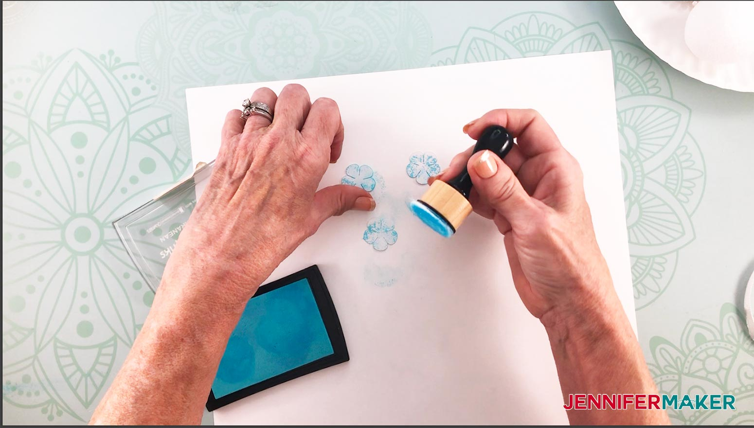 Make a paper hydrangea flower by inking the petals with stamp ink pad and ink dabber