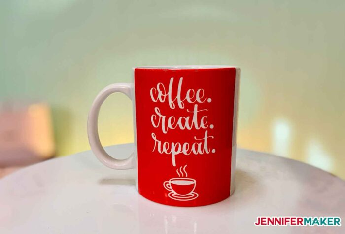 A red Cricut Infusible Ink mug made on a Cricut Mug Press